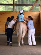 Therapeutic Rider in the Indoor